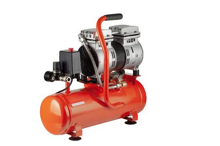 new, orange air compressor on white background