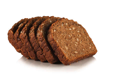 slices of rye bread with sunflower seeds on a white background