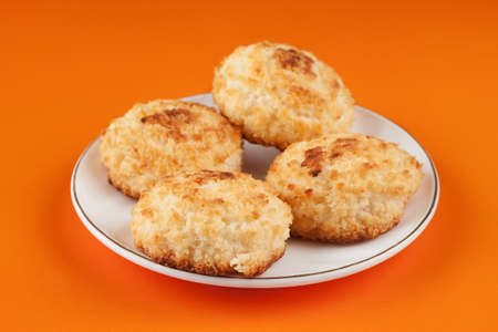 Four mouth-watering, delicious cookies with coconut crumbs