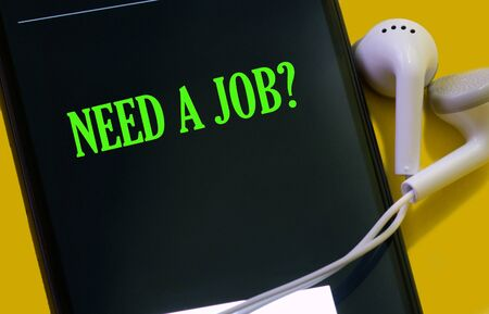 Inscription on smartphone screen - Need a job? Business consept