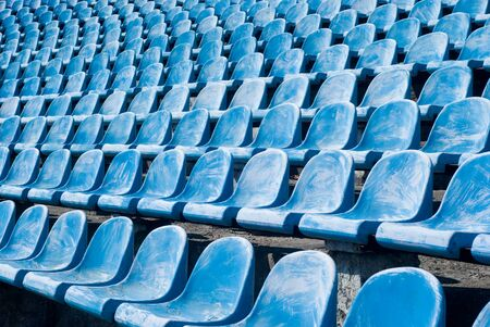 Many old blue chairs in a football stadium, for visitors needing replacement or reconstruction