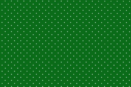 Background from small white circles on green. Texture speckled Stock Photo