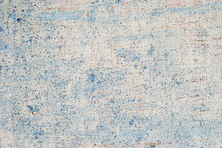 Texture of an old wooden door with peeling paint. blue color