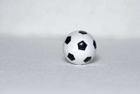 Small toy, plastic soccer ball on a white background Stock Photo