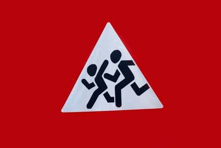sign signifying cautiously children, the image of children running across the road Stock Photo