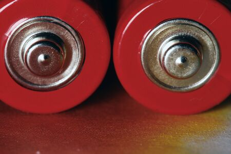 red batteries on the table,  close up macro Stock Photo