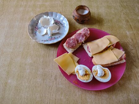 photo image of the sandwiches with ham and pate on the plate Standard-Bild