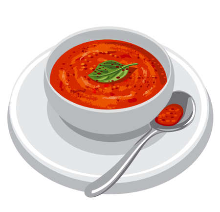 Bowl of tomato soup served with basil leaves