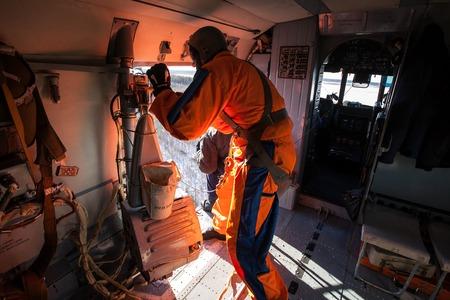 rescuer: Rescue operation. Air rescuer descends to the victim