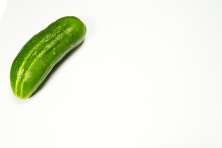 pimples: green cucumber in pimples on a white background