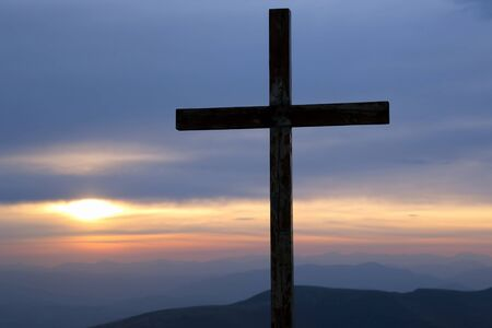 green cross: sunrise in the mountains Stock Photo