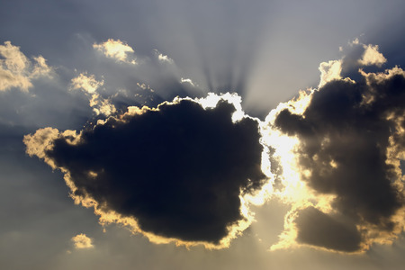 suns: the suns rays descend from the clouds Stock Photo