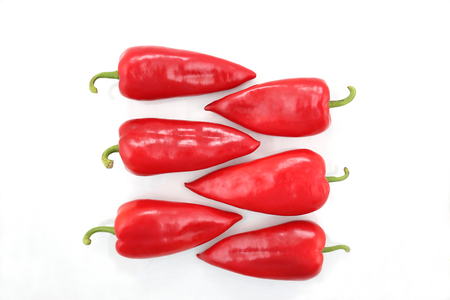 bell peper: six bright red sweet peppers on a white background