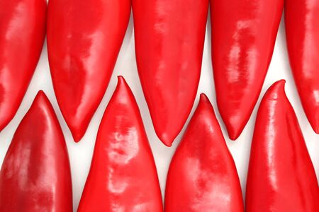 bell peper: a group of red sweet peppers on a white background