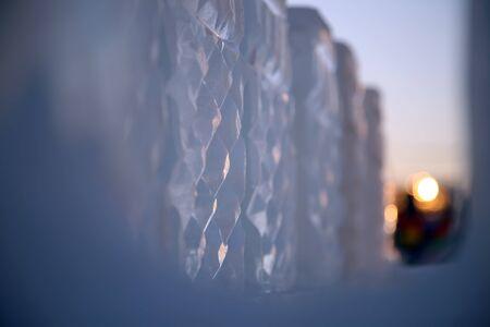 wintery snowy: ice figure against the sky and the sun