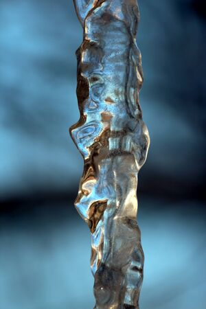 sopel lodu: transparent icicle close up against the sky Zdjęcie Seryjne