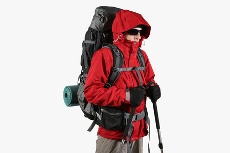 red mountain: tourist in red jacket with backpack and trekking sticks