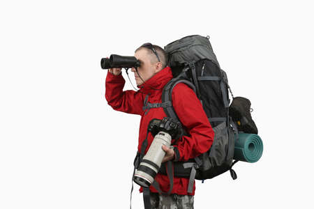 sleeping pad: the equipped with the traveler photographer in a red jacket on a white background looking through binoculars Stock Photo