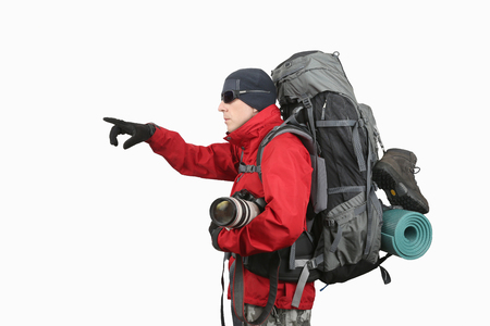 sleeping pad: traveler in red jacket with backpack and camera in hand points into the distance hand on white background