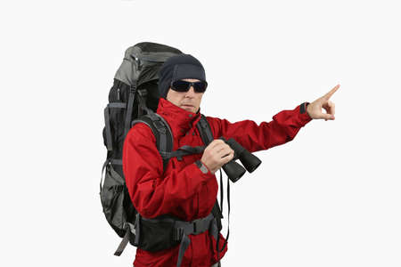 specifies: traveler with backpack red jacket with binoculars in hand on a white background specifies a finger into the distance