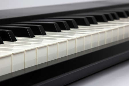 piano: the piano keys closeup on white background
