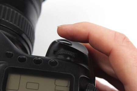 gatillo: the finger is near the trigger button is digital camera close up