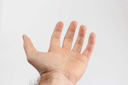 gesticulation: open the palm of the hand on a light background Stock Photo