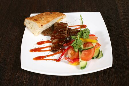 meat sauce: appetizer of grilled meat in sauce and vegetables