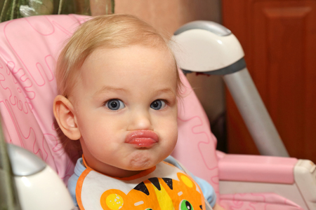 pouty: portrait of a little blond child with pouty lips Stock Photo