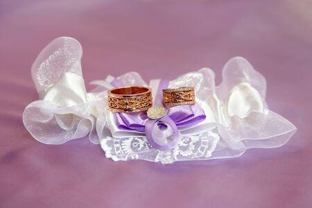 embellished: wedding rings lie on beautifully embellished fabrics Stock Photo