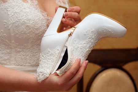 female soles: the bride looks on her wedding shoes