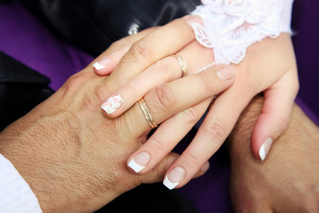 fingers put together: United hands of the bride and groom