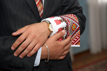 cufflink: the groom holds on its sleeve wedding towel