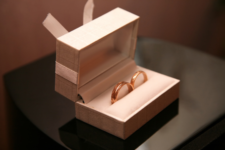 gold wedding rings lie in a box