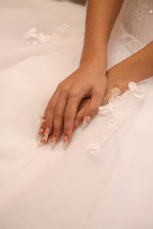 manicured hands: the bride is showing her manicured hands