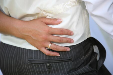 hugged: the hand of the bride hugged the grooms waist Stock Photo