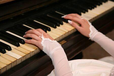 piano closeup: the bride plays the piano closeup