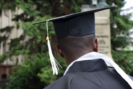 african student in the form of a university graduate  from behind closeup