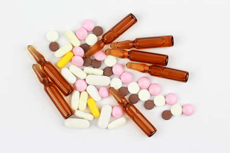 ampules: medicinal tablets, ampules for injections on white background