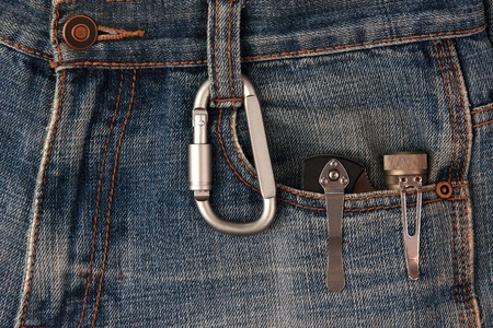 objec: metal carabiner and tools on the jeans