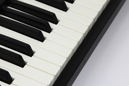 octave: the piano keys closeup on white background