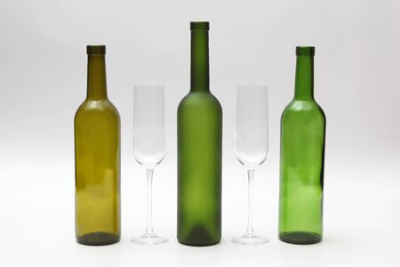 empty bottles and wine glasses on a white background