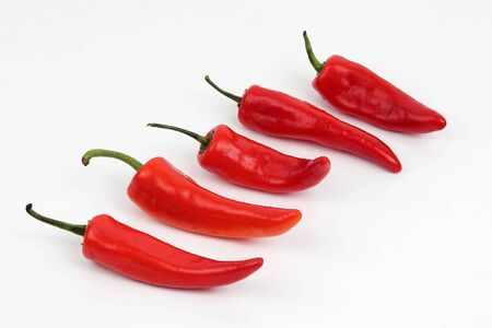 bell peper: five bright red sweet peppers on a white background