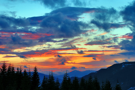 afterglow: very colorful sunset in the mountains Stock Photo