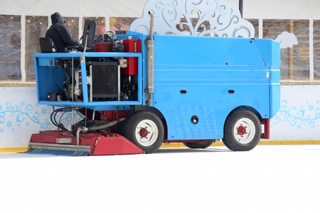 reconstruct: special machine ice harvester cleans the ice rink
