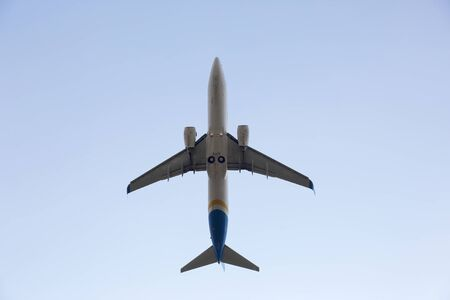 airstrip: passenger jet plane flying in the sky Stock Photo