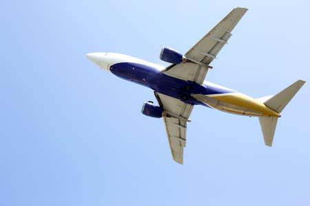 passenger jet flies in sky Stock Photo