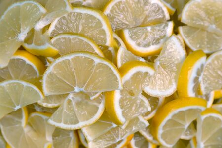 thinly sliced lemons closeup