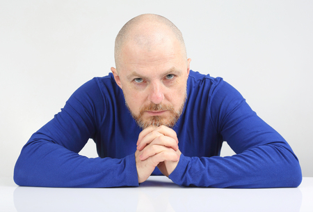 portrait of bearded and bald man on white background  Stock Photo
