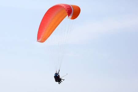 Paraglider flying on a wing in the sky